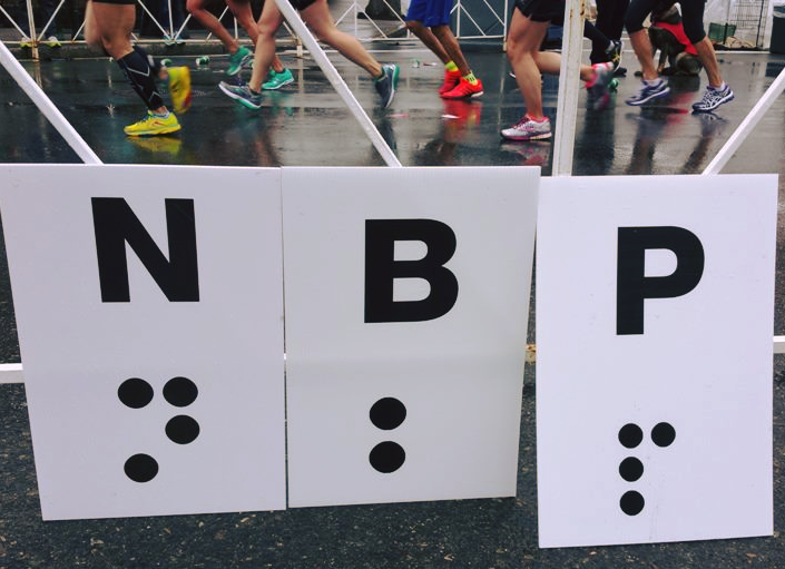 photo shows the print/braille nbp signs at the 2018 marathon