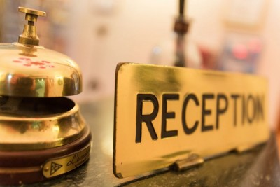 photo of a hotel reception desk and bell