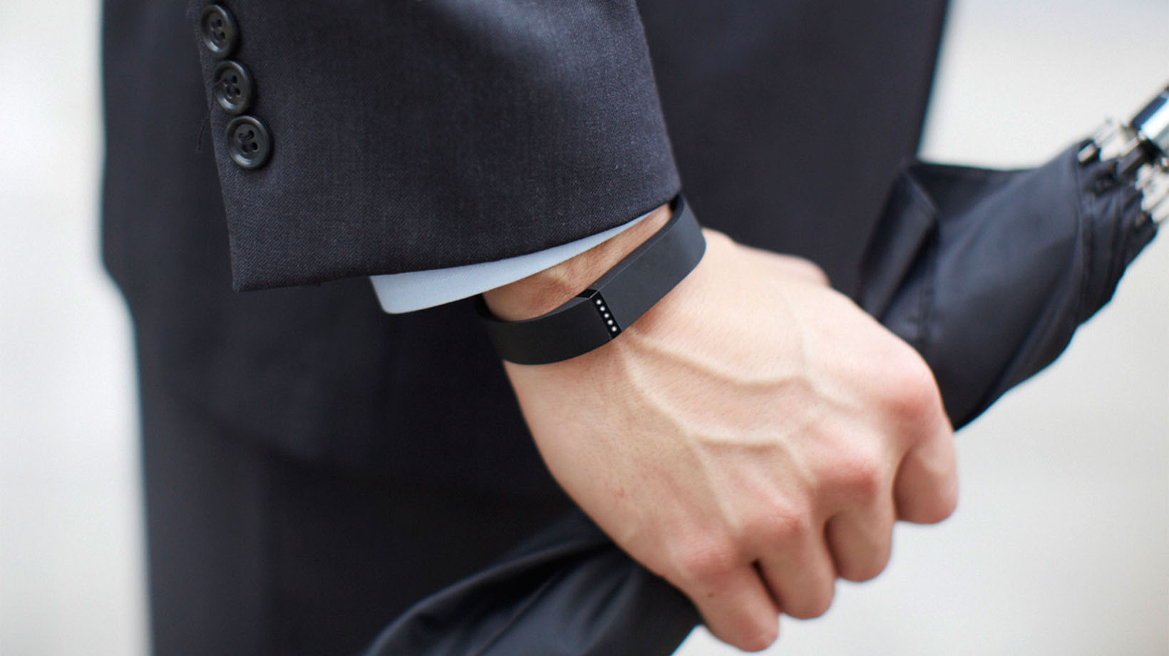 close up picture of a fitbit on a man's wrist
