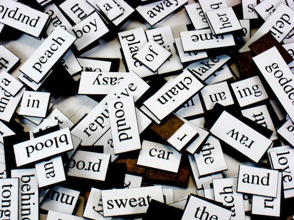 photo of a jumble of magnetic poetry words