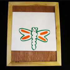 Photo of drawing board with drawing of a butterfly on it.