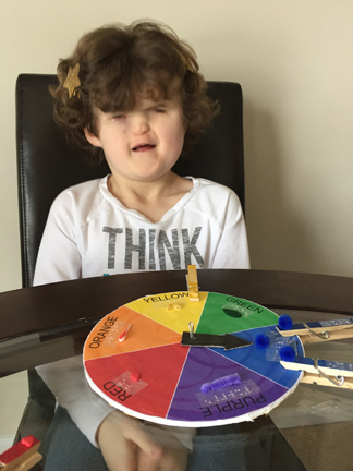 Girl smiling with color wheel game