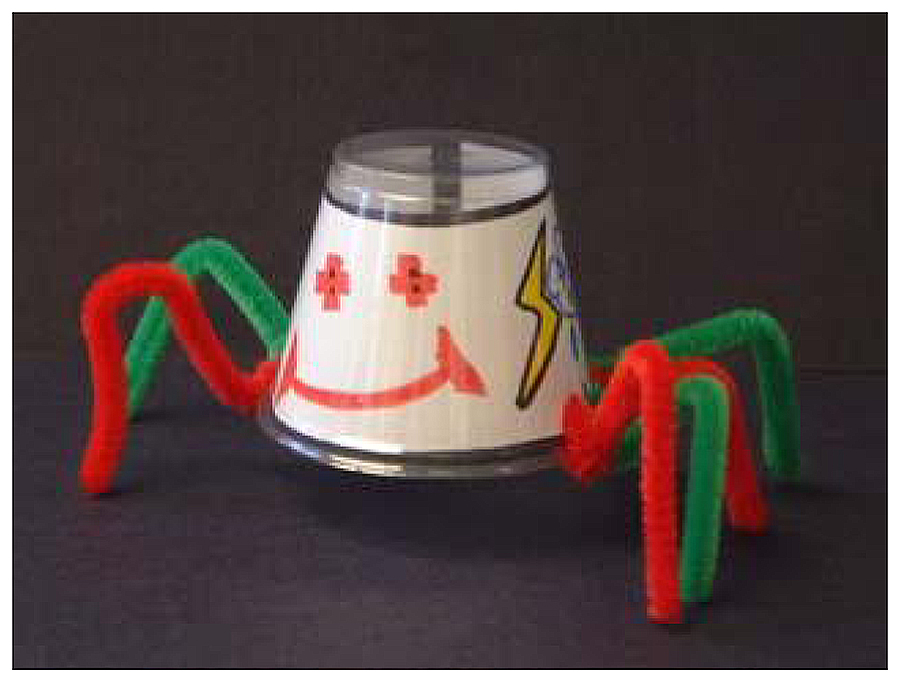 Anansi spider craft, made of plastic cup and pipe cleaners
