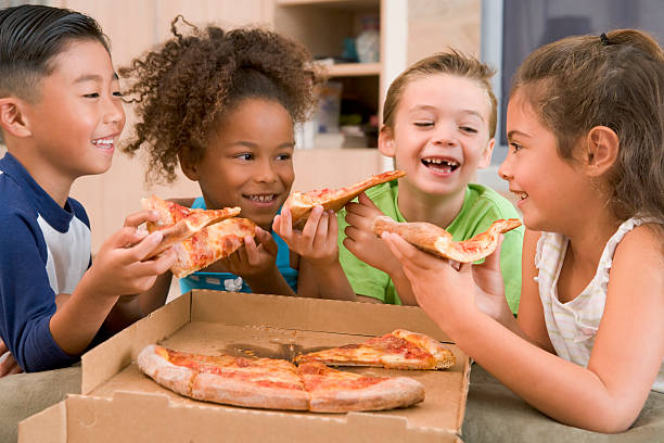 kids sharing slices of pizza