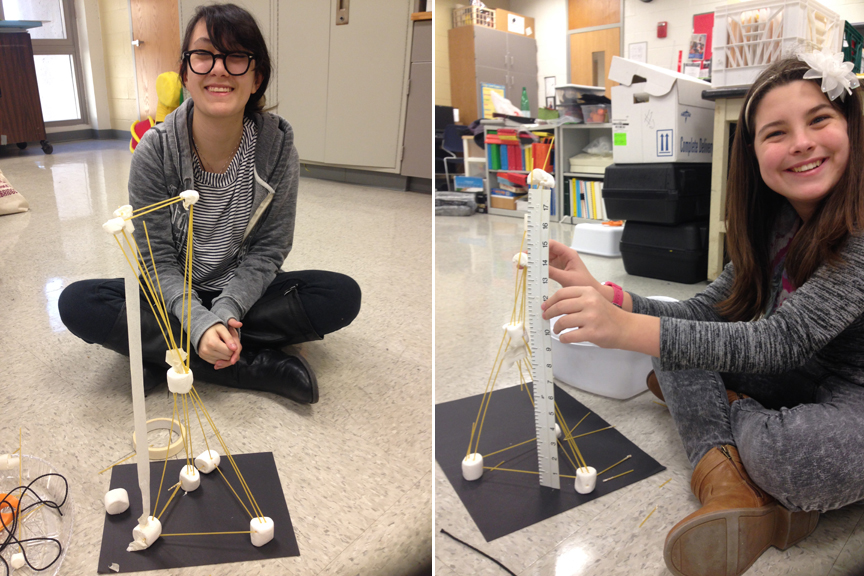 Two students show off their towers