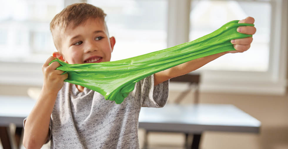 boy pulls green slime