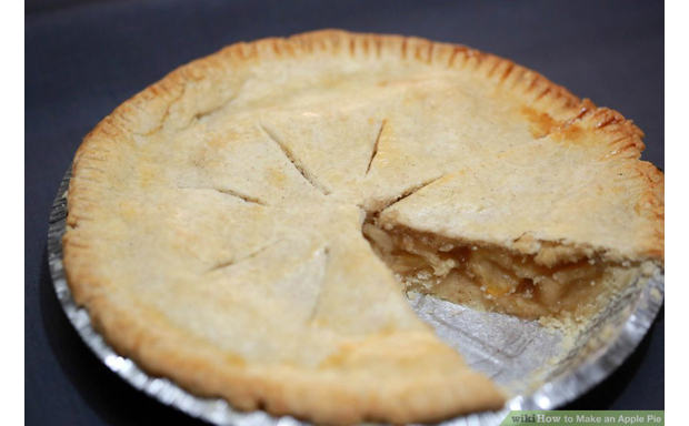 photo of apple pie with one wedge cut out