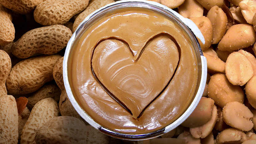 photo of a bowl of peanut butter sitting on peanuts