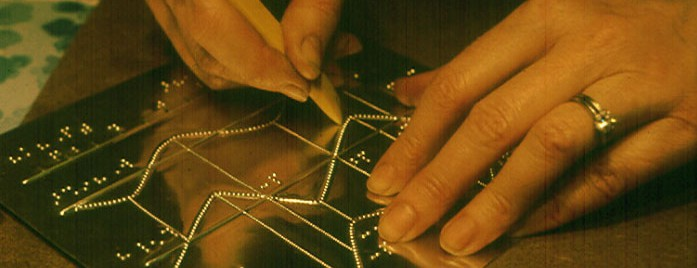 close up photo of hands creating a master for tactile map