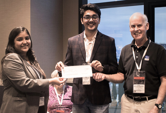 Brian MacDonald, NBP President, handing the winning check to InnoVision Technologies