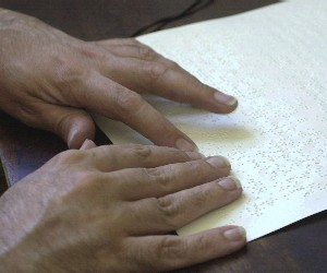 A proofreader checks braille both for typographical errors and machine-related errors